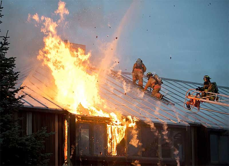 Firefighters battle flames above Sun Valley home